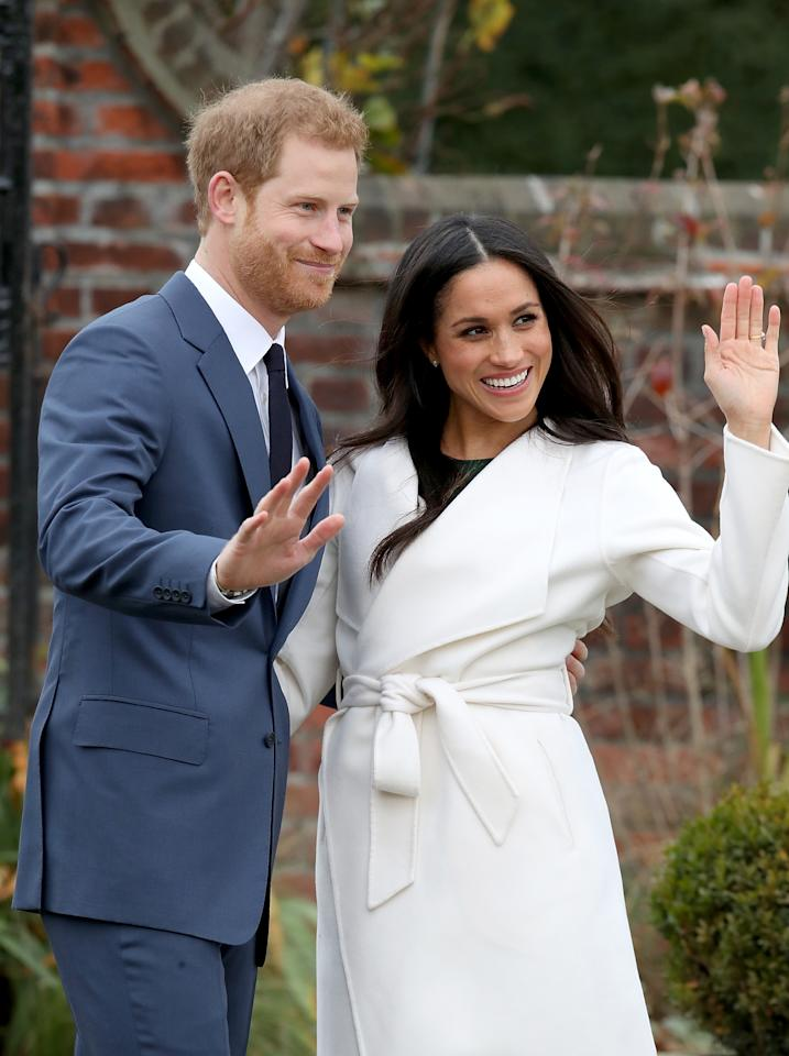 """<p>Here's a better look at her coat, which she wore over a green dress by P.A.R.O.S.H. Markle is a fan of Line the Label, which describes itself as """"effortless understated luxury,"""" and wore one of the company's trenches earlier. Of course, there's now speculation about who she will have design her wedding dress. Meghan has said that her favorite celebrity wedding dress of all time was <a rel=""""nofollow"""" href=""""https://www.glamour.com/story/suits-wedding-dress-rachel-zane"""">Carolyn Bessette Kennedy's Narciso Rodriguez slip dress</a>. She called it """"everything goals."""" (Photo: Getty Images) </p>"""