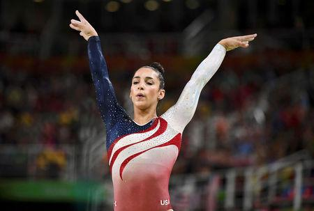 FILE PHOTO: Alexandra Raisman of USA competes on the beam during the women's team final in Artistic Gymnastics at the 2016 Rio Olympics in Rio de Janeiro, Brazil, August 9, 2016.     REUTERS/Dylan Martinez/File Photo