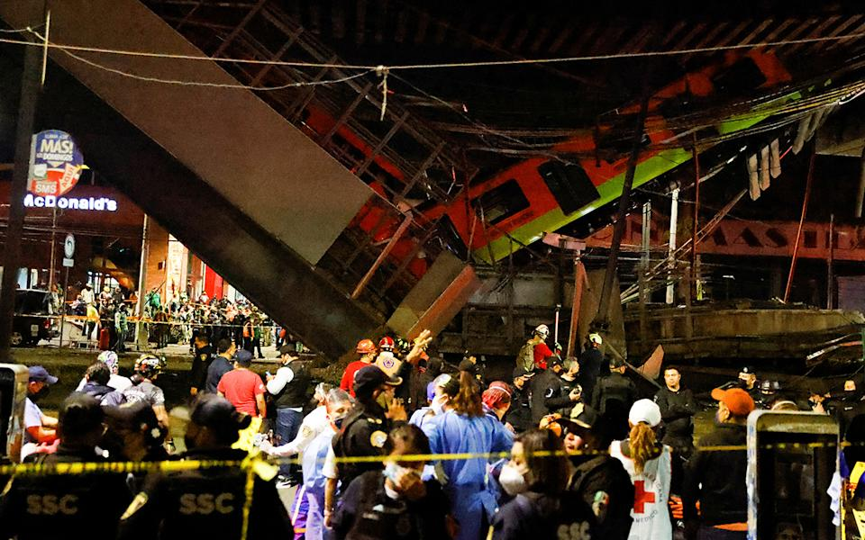 Rescuers work at a site where an overpass for a metro partially collapsed with train cars on it at Olivos station in Mexico City, Mexico May 3, 2021. REUTERS/Carlos Jasso
