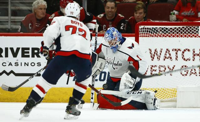Washington Capitals goaltender Pheonix Copley (1) makes a save on a shot against the Arizona Coyotes as Capitals center Travis Boyd (72) watches during the first period of an NHL hockey game Thursday, Dec. 6, 2018, in Glendale, Ariz. (AP Photo/Ross D. Franklin)