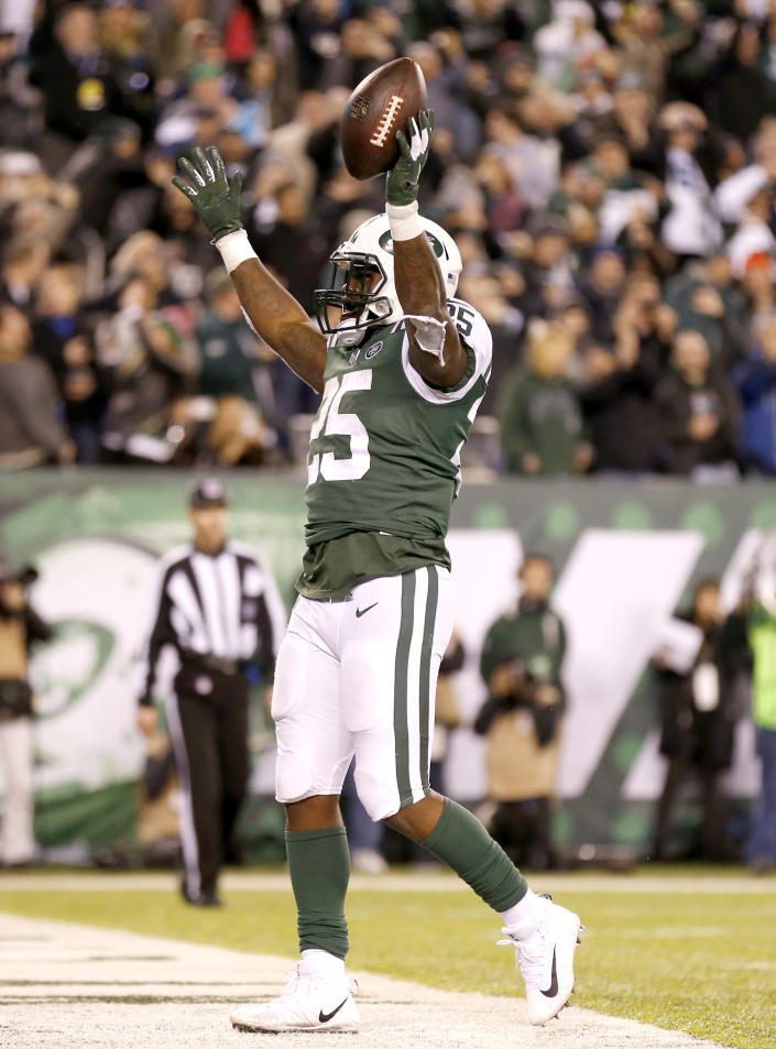 New York Jets running back Elijah McGuire celebrates his touchdown run against the Houston Texans during the second half of an NFL football game, Saturday, Dec. 15, 2018, in East Rutherford, N.J. (AP Photo/Adam Hunger)