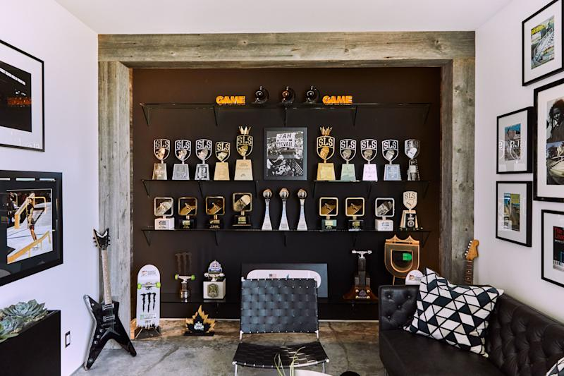"""""""The trophy room is my most proud space,"""" says Huston of the timber- and concrete-clad room built out to showcase the many wins and championships of his dynamic career thus far. """"I come in here and it only makes me want to work harder and keep going."""""""