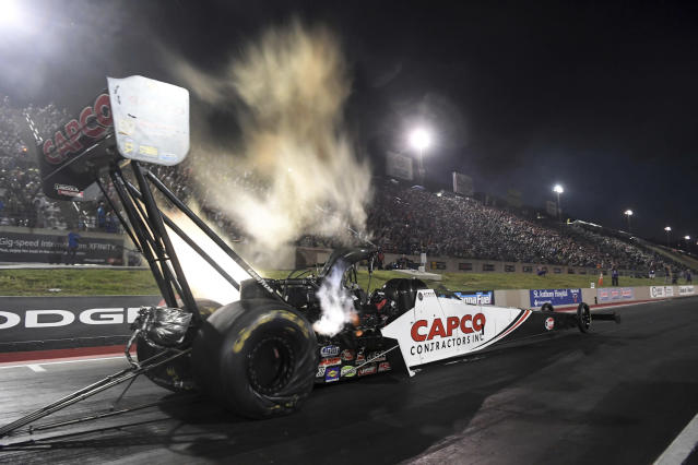 In this photo provided by the NHRA, Steve Torrence drives in Top Fuel qualifying Friday, July 19, 2019, for the Dodge Mile-High NHRA Nationals drag races at Bandimere Speedway in Morrison, Colo. (Jerry Foss/NHRA via AP)