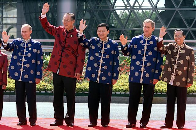 From left, Russia President Vladimir Putin, Prime Minister of Singapore Goh Chok Tong, Thai Prime Minister Thaksin Shinawatra, President George W. Bush and Vietnamese Prime Minister Phan Van Khai, after a meeting of Asia-Pacific Economic Cooperation (APEC) leaders, Oct. 21, 2001 in Shanghai. (Photo: Stephen Jaffe/AFP/Getty Images)