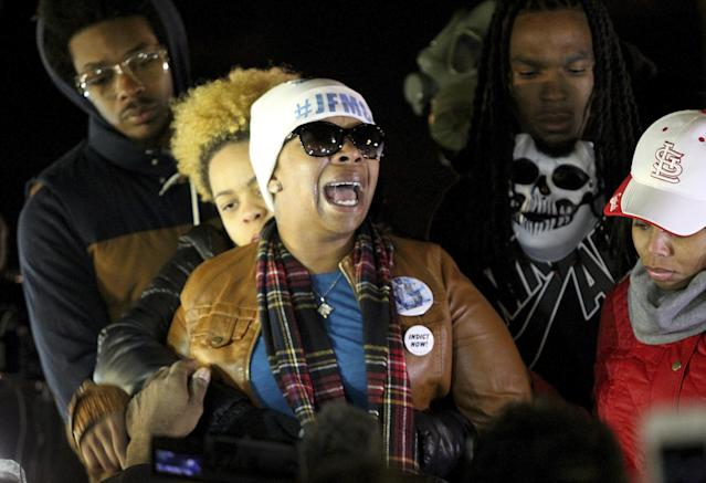 <p>Lezley McSpadden, center, Michael Brown's mother, cries on November 14, 2014, after learning of a grand jury's decision in St. Louis, Missouri, to not indict Ferguson, Missouri, police officer Darren Wilson. Wilson shot and killed Brown, 18, on August 9. (Timothy Tai/ZUMA Wire/ZUMAPRESS.com) </p>