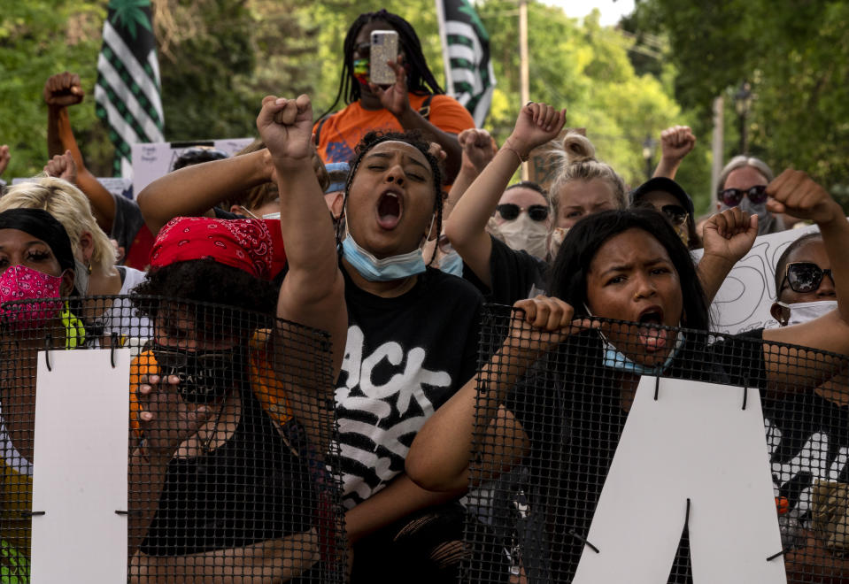 ST. ANTHONY, MN - JULY 06: Demonstrators march in honor of Philando Castile on July 6, 2020 in St. Anthony, Minnesota. Philando Castile was shot and killed during a traffic stop by Jeronimo Yanez, an officer with the St. Anthony Police Department, four years ago on July 6, 2016. (Photo by Stephen Maturen/Getty Images)