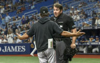 Miami Marlins manager Don Mattingly argues with home plate umpire John Libka, right, after Bryan De La Cruz was ejected during the first inning of a baseball game against the Tampa Bay Rays Friday, Sept. 24, 2021, in St. Petersburg, Fla. (AP Photo/Steve Nesius)