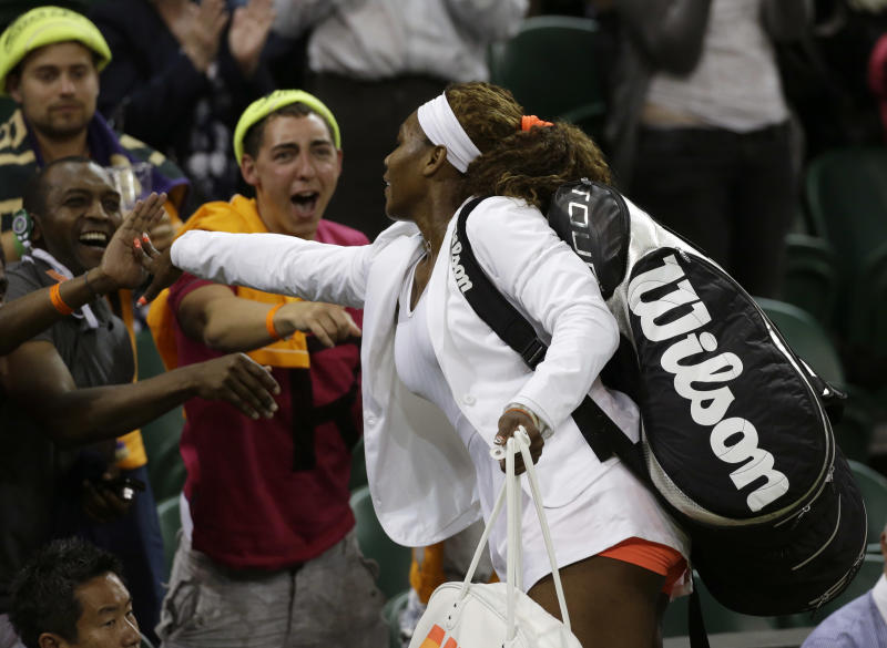 Serena Williams of the United States greets supporters after she defeated Kimiko Date-Krumm of Japan during their Women's singles match at the All England Lawn Tennis Championships in Wimbledon, London, Saturday, June 29, 2013. (AP Photo/Anja Niedringhaus)
