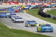 Matt DiBenedetto (21) and Chase Elliott (9) compete during a NASCAR Cup Series auto race Sunday, July 4, 2021, at Road America in Elkhart Lake, Wis. (AP Photo/Jeffrey Phelps)