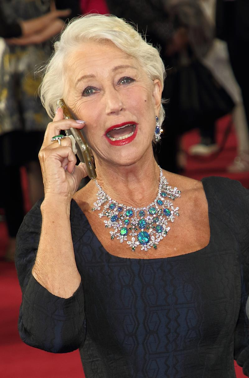 LONDON, UNITED KINGDOM - 2019/09/25: Dame Helen Mirren gets a call from her agent on the red carpet at the Sky Atlantic launch of their new TV series Catherine The Great at the Curzon Mayfair, London. (Photo by Keith Mayhew/SOPA Images/LightRocket via Getty Images)