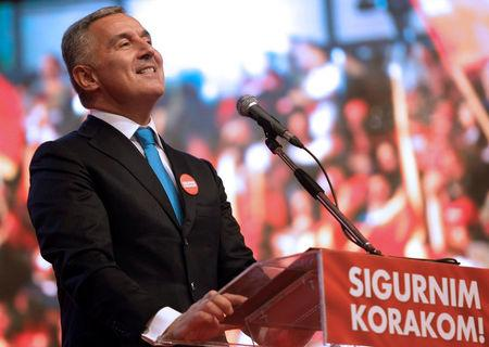 Montenegro's Prime Minister and leader of rulling Democratic Party of Socialist reacts during a pre-election rally in Podgorica, Montenegro