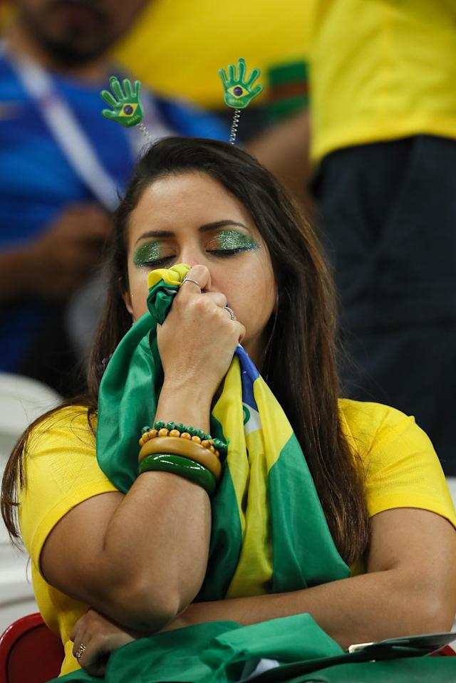 <p>A fan of Brazil looks dejected at the end of the 2018 FIFA World Cup Russia Quarter Final match between Brazil and Belgium at Kazan Arena on July 6, 2018 in Kazan, Russia. (Photo by Matthew Ashton – AMA/Getty Images) </p>