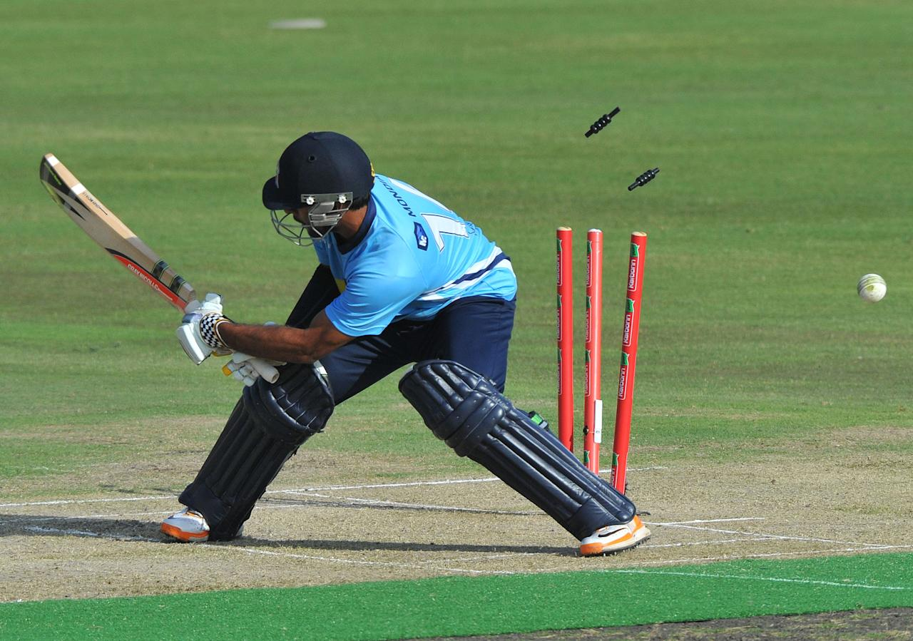 PRETORIA, SOUTH AFRICA - OCTOBER 23: (SOUTH AFRICA OUT) Ronnie Hira of Aces is bowled out by Joe Mennie of Perth during the Karbonn Smart CLT20 match between Auckland Aces and Perth Scorchers at SuperSport Park on October 23, 2012 in Pretoria, South Africa. (Photo by Duif du Toit/Gallo Images/Getty Images)