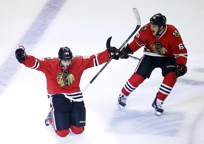 Chicago Blackhawks right wing Patrick Kane (88) celebrates his goal with center Andrew Shaw (65) during the second overtime period in Game 5 of the NHL hockey Stanley Cup playoffs Western Conference finals against the Los Angeles Kings, Saturday, June 8, 2013, in Chicago. The Blackhawks won 4-3 and advanced to the Stanley Cup finals. (AP Photo/Charles Rex Arbogast)