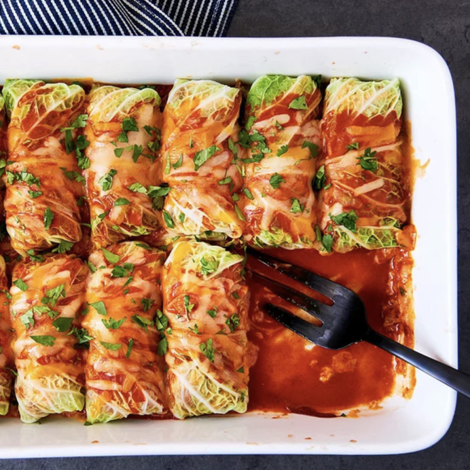 <p>This 5-ingredient dinner recipe uses two genius hacks to make dinner healthy and get it on the table in under an hour. First, swap in cabbage leaves for tortillas to cut the carbs and get an extra serving of vegetables. Second, use prepared ingredients--spicy refried beans and enchilada sauce--to add tons of flavor without a long ingredient list.</p>