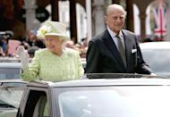 <p>Embracing the party spirit on a tour of Windsor to mark the monarch's 90th birthday. </p>