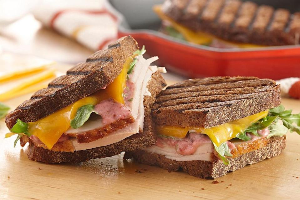 """<p>Pumpernickel slices star in this ultimate leftover panini. Is it unseasonably warm where you are? This recipe also makes an excellent addition to any <a href=""""https://www.thedailymeal.com/entertain/perfect-foods-every-picnic-our-40-best-recipes-slideshow?referrer=yahoo&category=beauty_food&include_utm=1&utm_medium=referral&utm_source=yahoo&utm_campaign=feed"""" rel=""""nofollow noopener"""" target=""""_blank"""" data-ylk=""""slk:picnic basket menu."""" class=""""link rapid-noclick-resp"""">picnic basket menu.</a></p> <p><a href=""""https://www.thedailymeal.com/best-recipes/leftover-turkey-panini?referrer=yahoo&category=beauty_food&include_utm=1&utm_medium=referral&utm_source=yahoo&utm_campaign=feed"""" rel=""""nofollow noopener"""" target=""""_blank"""" data-ylk=""""slk:For the Ultimate Leftover Turkey Panini recipe, click here."""" class=""""link rapid-noclick-resp"""">For the Ultimate Leftover Turkey Panini recipe, click here.</a></p>"""