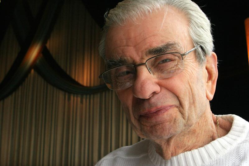"""FILE - This Feb. 10, 2006 file photo shows composer and lyricist Richard Adler in New York. Adler, who won Tony Awards for co-writing the songs for such hit musicals as """"The Pajama Game"""" and """"Damn Yankees,"""" died Thursday, June 21, 2012 at his home in Southampton, N.Y., according to his family. He was 90. Some of Adler's biggest songs are """"You Gotta Have Heart,"""" """"Hey, There,"""" """"Hernando's Hideaway,"""" """"Whatever Lola Wants,"""" """"Steam Heat,"""" """"Rags to Riches,"""" and """"Everybody Loves a Lover."""" (AP Photo/Tina Fineberg, file)"""