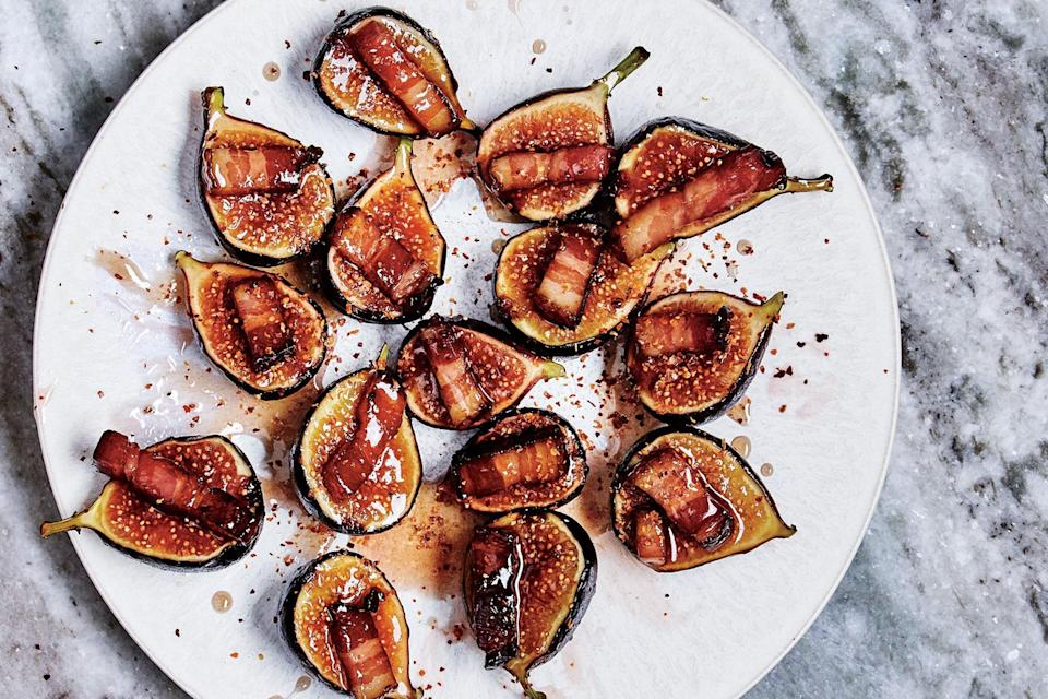 """When you start seeing ripe figs at your local market, pounce on them so you can make this easy—but perfect—appetizer. <a href=""""https://www.epicurious.com/recipes/food/views/figs-with-bacon-and-chile?mbid=synd_yahoo_rss"""" rel=""""nofollow noopener"""" target=""""_blank"""" data-ylk=""""slk:See recipe."""" class=""""link rapid-noclick-resp"""">See recipe.</a>"""