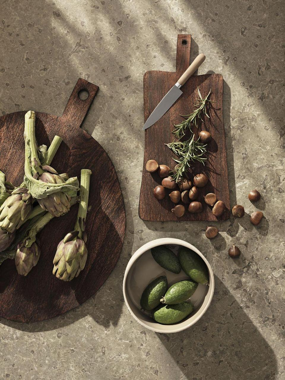 """<p>Get set for summer with H&M Home's beautiful wooden serving boards — perfect to show off at a dinner party.</p><p>'Our cutting boards are made with FSC certified Acacia wood,' explain H&M Home. 'This type of wood is well-known for its hardness and the grain can vary between straight and wavy patterns, while the shade of colour can range from light amber to a dark mahogany.'</p><p><a class=""""link rapid-noclick-resp"""" href=""""https://go.redirectingat.com?id=127X1599956&url=https%3A%2F%2Fwww2.hm.com%2Fen_gb%2Fhome.html&sref=https%3A%2F%2Fwww.housebeautiful.com%2Fuk%2Flifestyle%2Fshopping%2Fg36671419%2Fhandm-home-love-of-craft-collection-artisans%2F"""" rel=""""nofollow noopener"""" target=""""_blank"""" data-ylk=""""slk:COMING SOON"""">COMING SOON</a></p>"""
