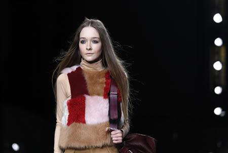 A model presents a creation from Topshop Unique Autumn/Winter 2014 collection during London Fashion Week
