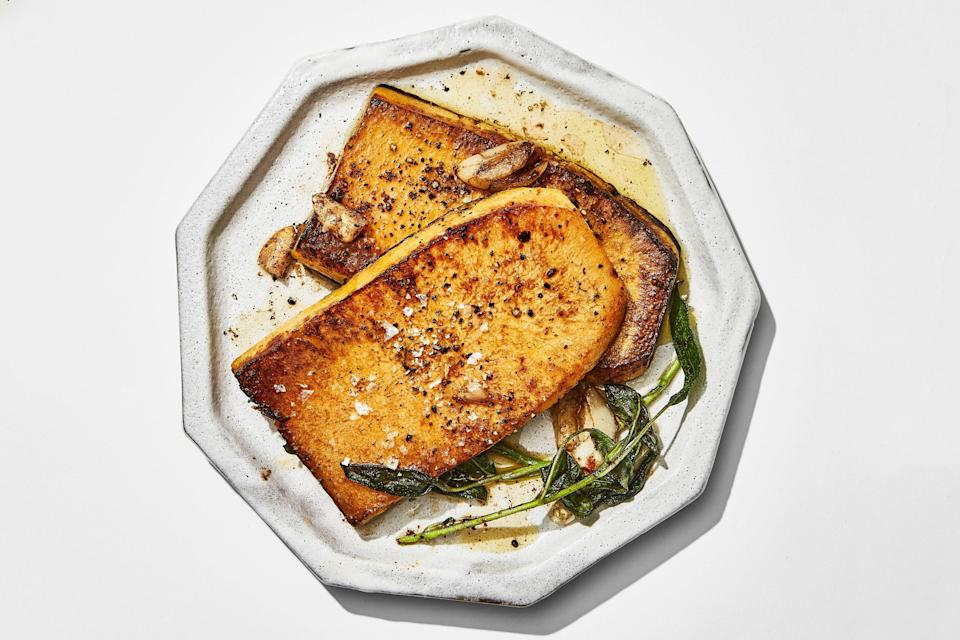"""Canadian Thanksgiving should be a special meal for everyone—whether they eat meat or not. Here, butternut squash gets the steakhouse butter-basting treatment, which turns it into a glorious main course. <a href=""""https://www.epicurious.com/recipes/food/views/butternut-squash-steaks-with-brown-buttersage-sauce?mbid=synd_yahoo_rss"""" rel=""""nofollow noopener"""" target=""""_blank"""" data-ylk=""""slk:See recipe."""" class=""""link rapid-noclick-resp"""">See recipe.</a>"""