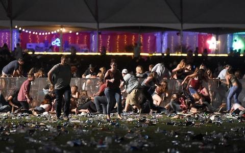 Festival-goers run for their lives in Las Vegas - Credit: David Becker/Getty