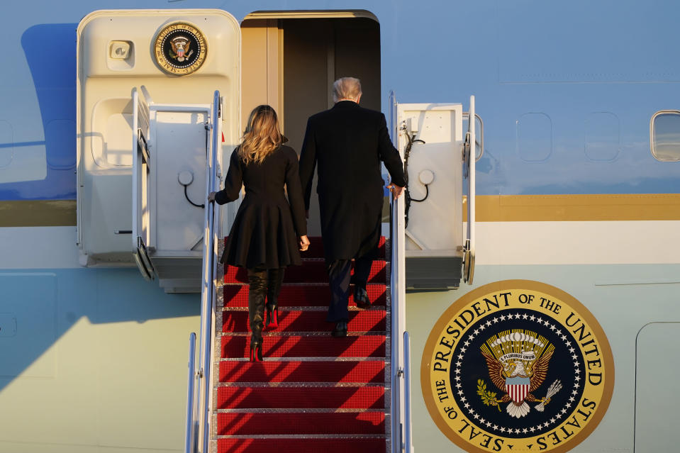 President Donald Trump and first lady Melania Trump, board Air Force One at Andrews Air Force Base, Md., Wednesday, Dec. 23, 2020. Trump is traveling to his Mar-a-Lago resort in Palm Beach, Fla. (AP Photo/Jacquelyn Martin)
