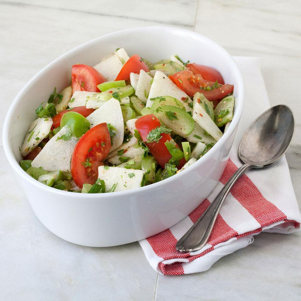 <p>This super-fresh salad spiked with crushed red pepper is a riot of tastes and textures--tart tomatillos, sweet and juicy ripe tomatoes and cooling and crunchy jicama. It makes an excellent side dish to a grilled steak.</p>