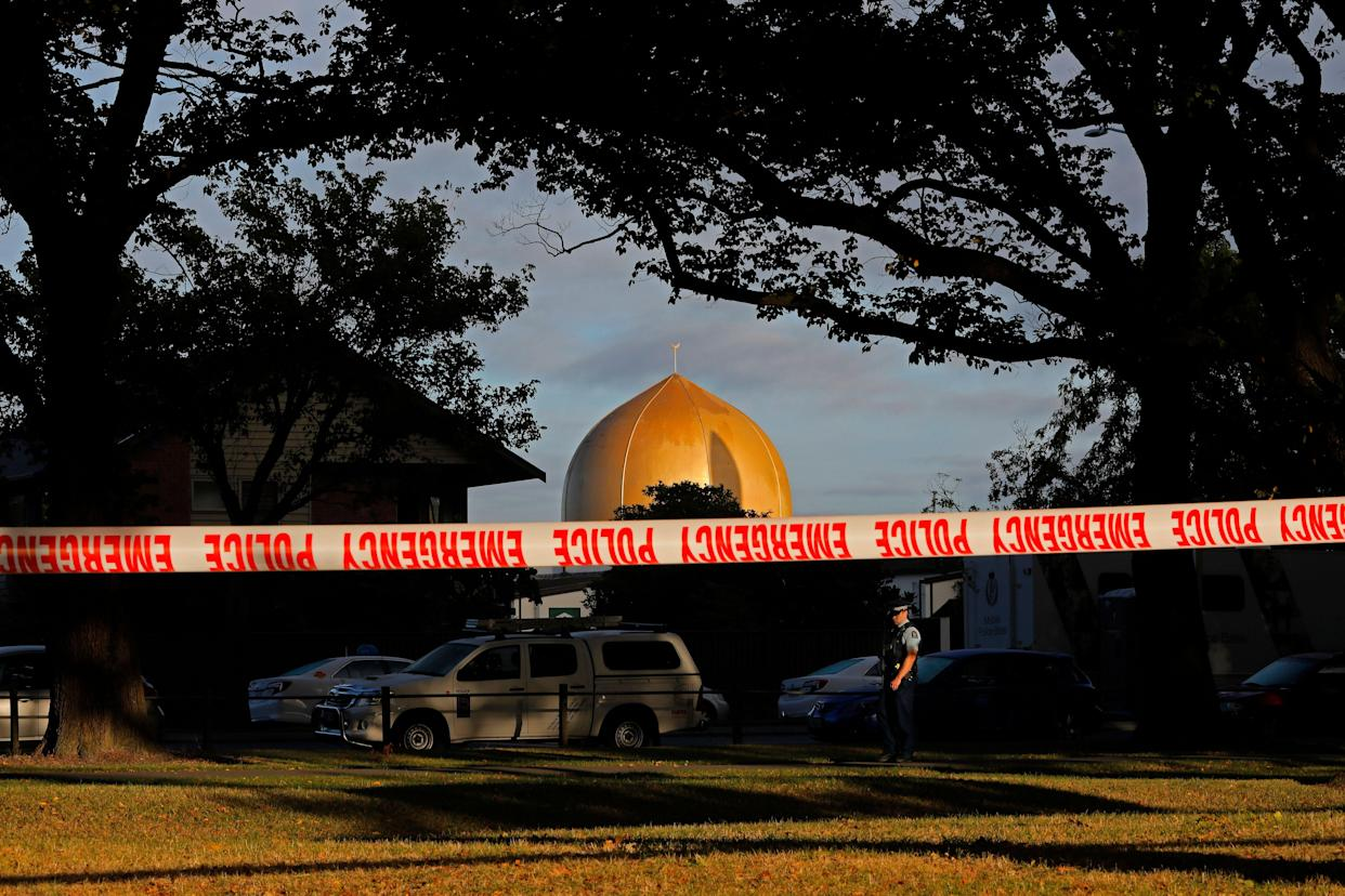 A police officer stands guard in front of the Masjid Al Noor mosque in Christchurch, New Zealand, where one of two mass shootings occurred on March 15. (Photo: Vincent Yu/AP)