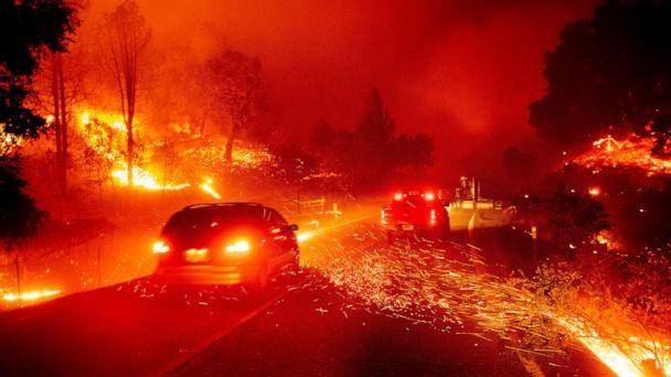 PHOTO: Embers fly across a roadway as the Kincade Fire burns through the Jimtown community of Sonoma County, Calif., Oct. 24, 2019. (Noah Berger/AP)