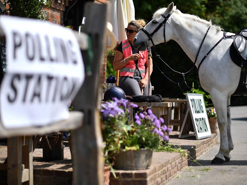 A voter sits with her horse after riding to a polling station set up in a pub near Tonbridge, Kent: AFP/Getty