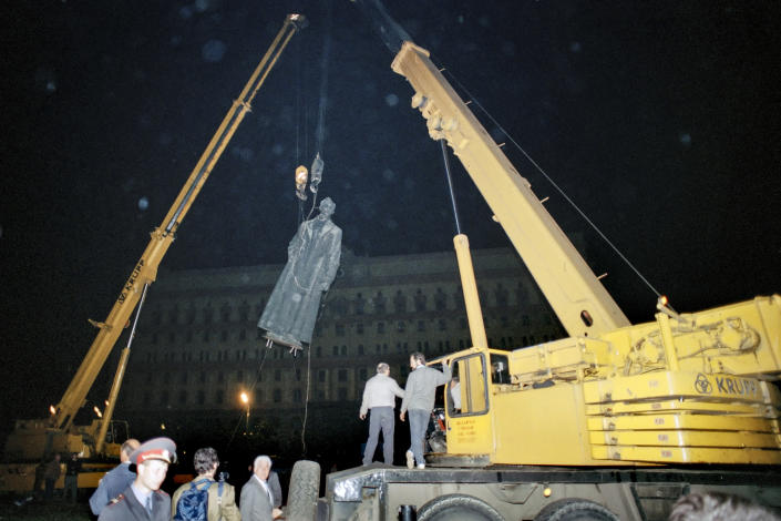 FILE - In this Friday, Aug. 23, 1991 file photo, The statue of the founder of the KGB, Felix Edmundovich Dzerzhinsky, is toppled off its pedestal in front of KGB headquarters in Moscow, Russia. When a group of top Communist officials ousted Soviet leader Mikhail Gorbachev 30 years ago and flooded Moscow with tanks, the world held its breath, fearing a rollback on liberal reforms and a return to the Cold War confrontation. But the August 1991 coup collapsed in just three days, precipitating the breakup of the Soviet Union that plotters said they were trying to prevent. (AP Photo/Alexander Zemlianichenko, File)