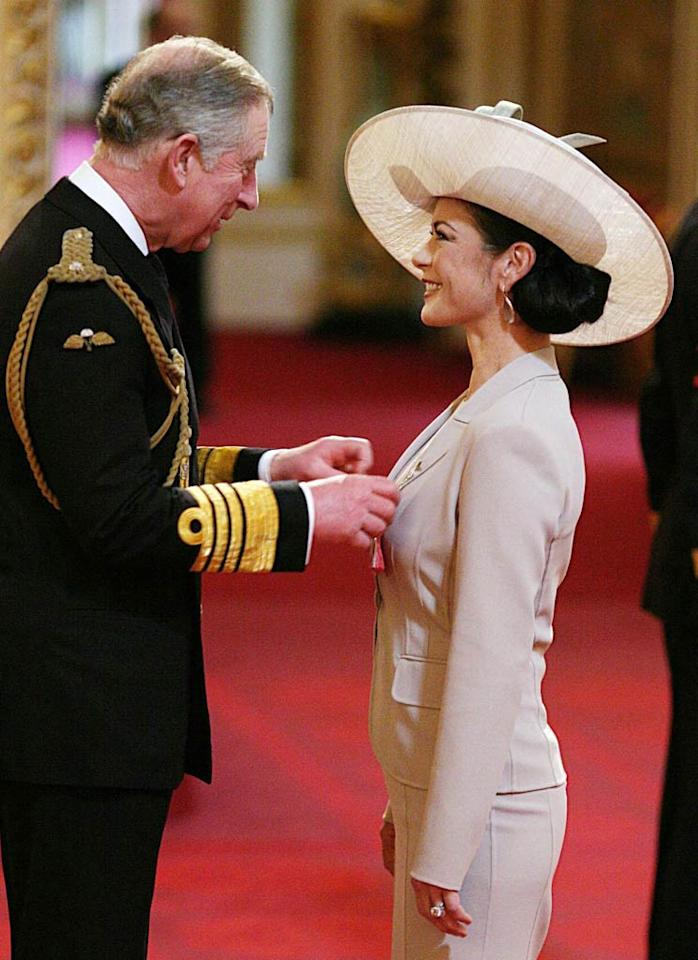 "Catherine Zeta-Jones was made a Commander of the Order of the British Empire by Prince Charles at Buckingham Palace in London on Thursday. At the ceremony attended by her husband Michael Douglas, and children Dylan and Carys, the Oscar-winning Welsh actress was honored for her services to the film industry and charity. Zeta-Jones said she was ""absolutely thrilled"" with the award, adding, ""As a British subject I feel incredibly proud. At the same time it is overwhelming and humbling."" AP/Lewis Whyld"