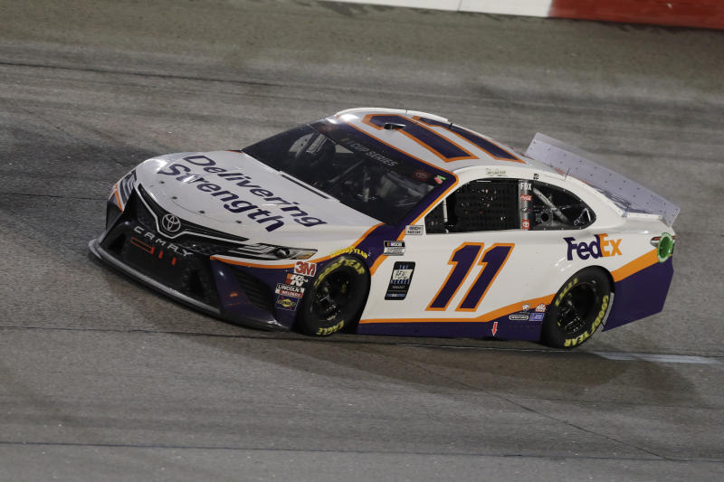 Denny Hamlin (11) drives during the NASCAR Cup Series auto race Wednesday, May 20, 2020, in Darlington, S.C. (AP Photo/Brynn Anderson)