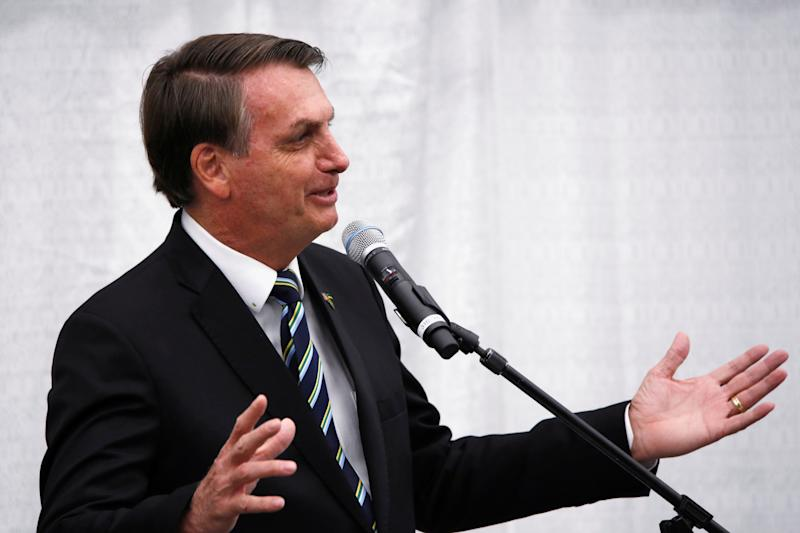 Brazilian President Jair Bolsonaro gestures as he speaks during a meeting with the Brazilian community at The Miami Dade College Auditorium, in Miami, Florida, U.S., March 9, 2020. REUTERS/Marco Bello