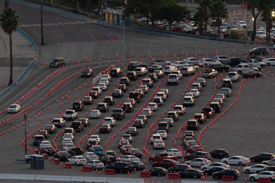 Cars line up at a Covid-19 drive-thru testing site in the parking lot of Dodger Stadium in Los Angeles, California, US.