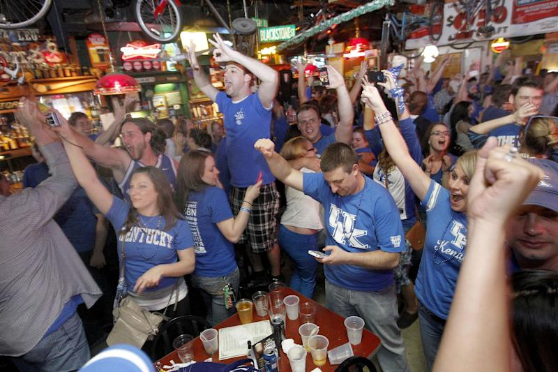 University of Kentucky fans celebrate after the final horn on Monday, April 2, 2012 at Lynagh's Irish Pub & Grill at University Plaza on Woodland Ave. in Lexington, Ky. University of Kentucky fans cheered on UK to victory in the Final Four championship game as they watched the Wildcats defeat Kansas 67-59. (AP Photo/David Perry,Lexington-Herald Leader)