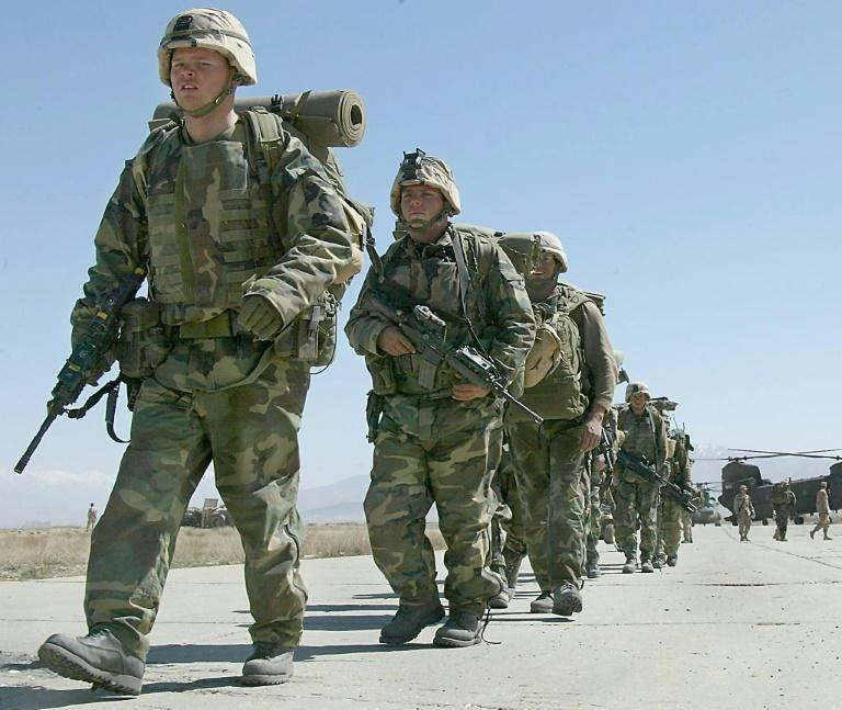 """US soldiers arrive at Bagram Air Base in Afghanistan in March 2002 as US-backed Afghan forces had seized key terrain and taken Taliban and al-Qaeda fighters prisoner in the early months of the """"war on terror"""""""