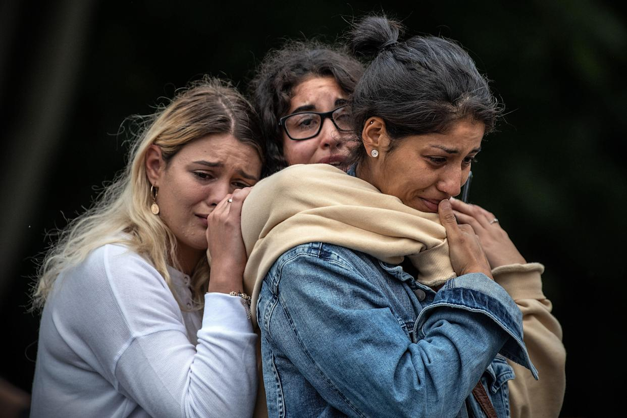 Young women weep as they hold each other for comfort during a students vigil near Al Noor mosque on March 18, 2019 in Christchurch, New Zealand. (Photo: Carl Court/Getty Images)