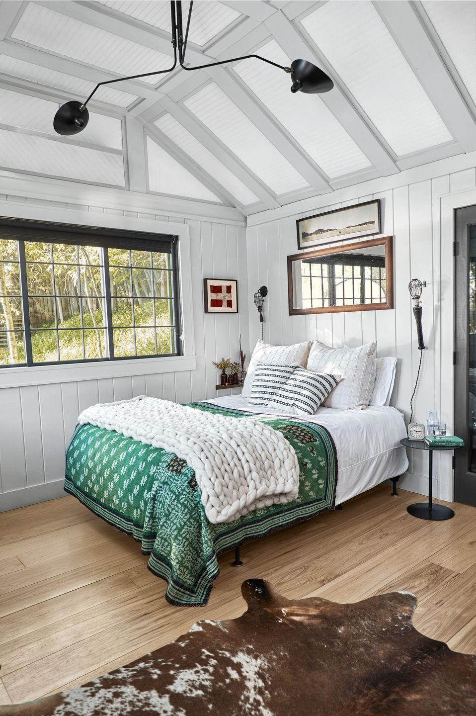 """<p>For a look that is airy and refined, understated greige makes the perfect color choice. Let the architecture of your room inform your design decisions. By painting the exposed ceiling beams the same color as the planked walls, homeowner Vincent Mazeau added some visual interest and kept the ceiling from feeling too lofty. </p><p><strong>Get the Look: </strong><br>Wall Paint Color: <a href=""""https://www.clare.com/paint/wall/penthouse"""" rel=""""nofollow noopener"""" target=""""_blank"""" data-ylk=""""slk:Penthouse by Clare"""" class=""""link rapid-noclick-resp"""">Penthouse by Clare</a></p>"""