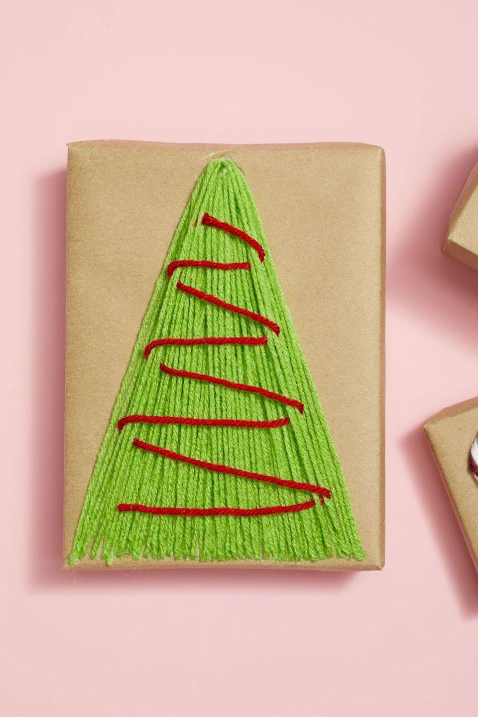<p>Take advantage of all the extra boxes you have lying around the house and use them for gift-giving. Wrap them in kraft paper and add a tree motif on top out of green and red yarn. </p>