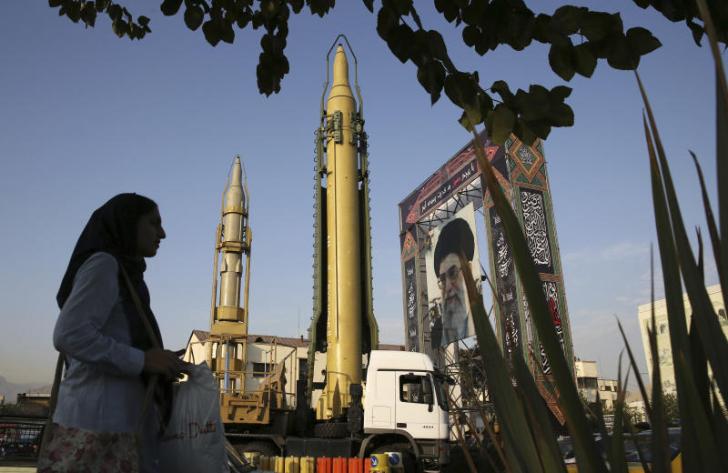 "FILE-- In this Sept. 24, 2017 file photo, surface-to-surface missiles and a portrait of the Iranian Supreme Leader Ayatollah Ali Khamenei are displayed by the Revolutionary Guard in an exhibition marking the anniversary of outset of the 1980s Iran-Iraq war, at Baharestan Square in Tehran, Iran. On Monday, April 8, 2019, the Trump administration designated Iran's Revolutionary Guard a ""foreign terrorist organization"" in an unprecedented move against a national armed force. Iran's Revolutionary Guard Corps went from being a domestic security force with origins in the 1979 Islamic Revolution to a transnational fighting force. (AP Photo/Vahid Salemi, File)"