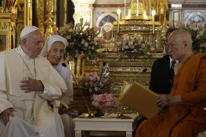 Pope Francis, left, and his cousin, Sister Ana Rosa Sivori visit the Supreme Buddhist Patriarch at Was Ratchabophit Sathit Maha Simaram Temple, Thursday, Nov. 21, 2019, in Bangkok, Thailand. (AP Photo/Gregorio Borgia)