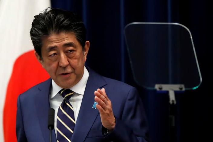 FILE PHOTO - Japan's PM Abe holds news conference on coronavirus disease (COVID-19) in Japan