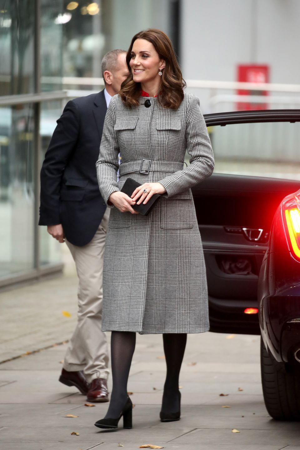 """<p>While attending the Children's Global Media Summit in Manchester, Kate wore <a href=""""https://www.lkbennett.com/product/CCDELLIACRYLICMIXPrintBlack%20White~Delli-Check-Coat-Black%20White"""" rel=""""nofollow noopener"""" target=""""_blank"""" data-ylk=""""slk:a gray checkered coat from L.K. Bennett"""" class=""""link rapid-noclick-resp"""">a gray checkered coat from L.K. Bennett</a> paired with sheer black tights and pumps.</p>"""