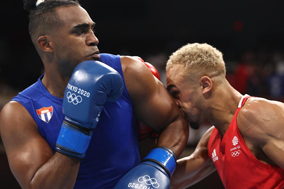Britain's Benjamin Whittaker (red) and Cuba's Arlen Lopez fight during their men's light heavy (75-81kg) boxing final bout during the Tokyo 2020 Olympic Games at the Kokugikan Arena in Tokyo on August 4, 2021. (Photo by Buda Mendes / POOL / AFP) (Photo by BUDA MENDES/POOL/AFP via Getty Images)