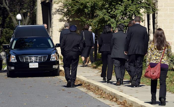 People arrive for the funeral service for Navy Yard shooting victim John R. Johnson at Good Shepherd Lutheran Church in Gaithersburg, Md., Tuesday, Sept. 24, 2013. (AP Photo/Susan Walsh)