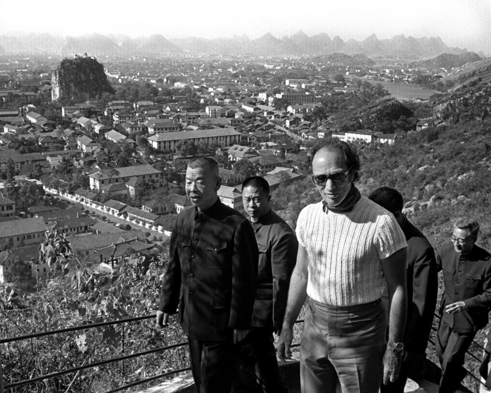Former prime minister Pierre Trudeau climbing a mountain overlooking Guilin, China, on Oct. 17, 1973. THE CANADIAN PRESS/PETER BREGG