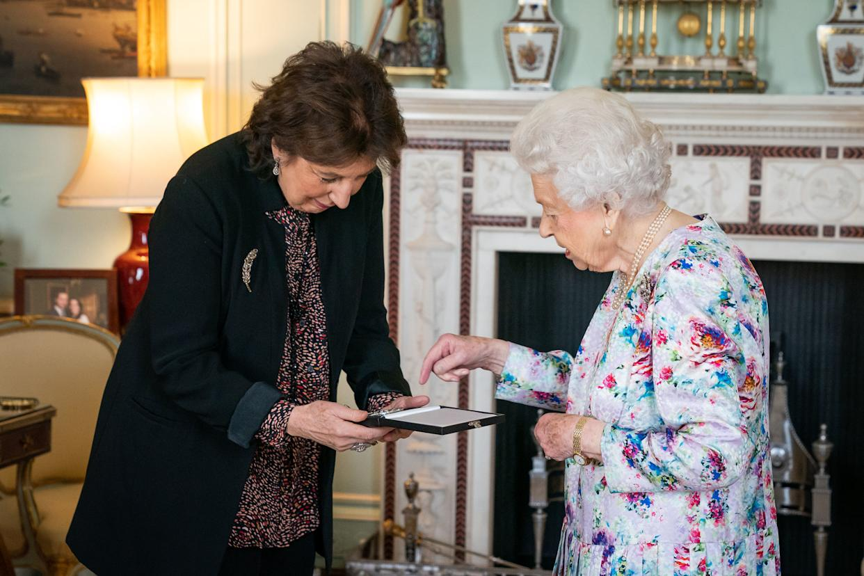 Dame Imogen Cooper is received by Queen Elizabeth II at Buckingham Palace where she was presented with The Queen's Medal for Music for 2019.